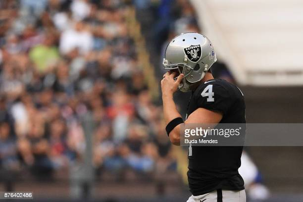 Derek Carr of the Oakland Raiders reacts against the New England Patriots during the second half at Estadio Azteca on November 19 2017 in Mexico City...