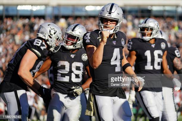 Derek Carr of the Oakland Raiders reacts to throwing a touchdown pass during the first half against the Cincinnati Bengals at RingCentral Coliseum on...