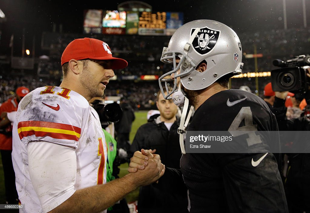 Derek Carr #4 of the Oakland Raiders shakes hands with Alex Smith #11 of the Kansas City Chiefs after the Raiders beat the Chiefs for their first win of the season at O.co Coliseum on November 20, 2014 in Oakland, California.