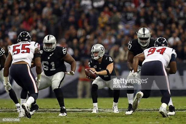 Derek Carr of the Oakland Raiders takes a snap against the Houston Texans at Estadio Azteca on November 21 2016 in Mexico City Mexico