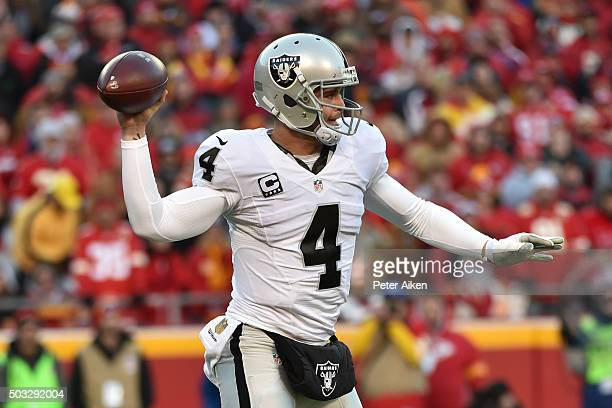 Derek Carr of the Oakland Raiders throws a pass at Arrowhead Stadium during the first quarter of the game against the Kansas City Chiefs on January 3...