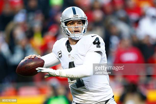 Derek Carr of the Oakland Raiders throws a pass at Arrowhead Stadium during the second quarter of the game against the Kansas City Chiefs on January...