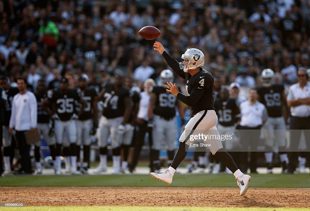 Derek Carr #4 of the Oakland Raiders throws the ball against the Arizona Cardinals at O.co Coliseum on August 30, 2015 in Oakland, California.