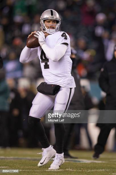 Derek Carr of the Oakland Raiders warms up prior to the game against the Philadelphia Eagles at Lincoln Financial Field on December 25 2017 in...