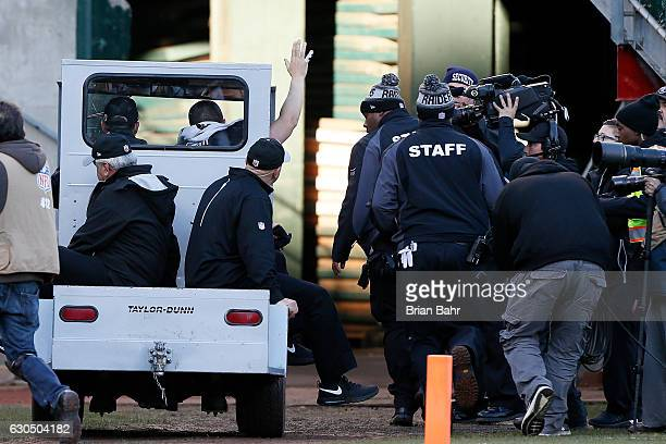 Derek Carr of the Oakland Raiders waves to the crowd as he is carted off the field after injuring his right leg during their NFL game against the...