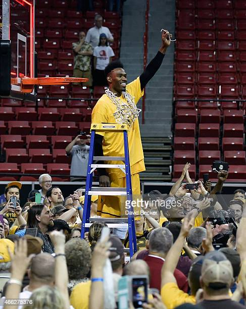Derek Cooke Jr #11 of the Wyoming Cowboys celebrates with a piece of the net after defeating the San Diego State Aztecs during the championship game...