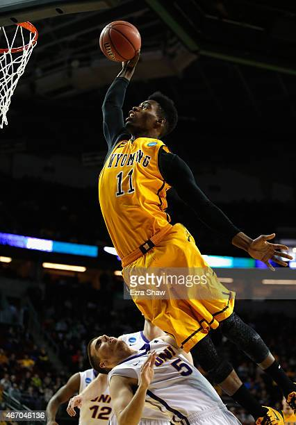 Derek Cooke Jr #11 of the Wyoming Cowboys jumps to take a shot over Matt Bohannon of the Northern Iowa Panthers during the first half of their game...