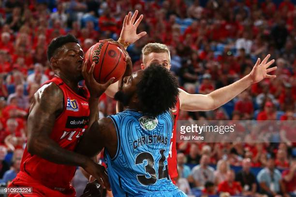 Derek Cooke Jr and Jesse Wagstaff of the Wildcats look to block Rakeem Christmas of the Breakers during the round 16 NBL match between the Perth...