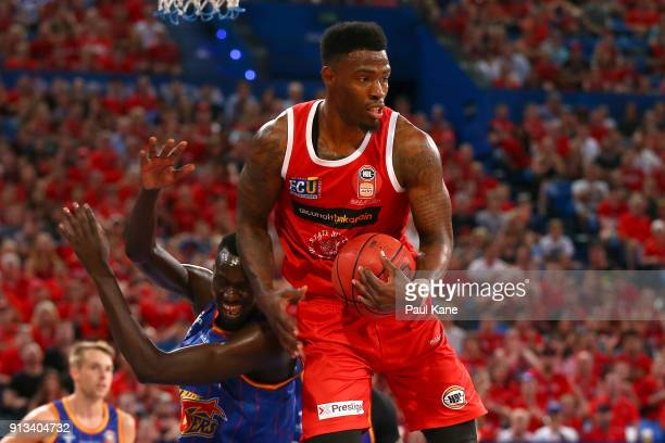 Derek Cooke Jr of the Wildcats pulls down a rebound against Majok Deng of the 36ers during the round 17 NBL match between the Perth Wildcats and the...