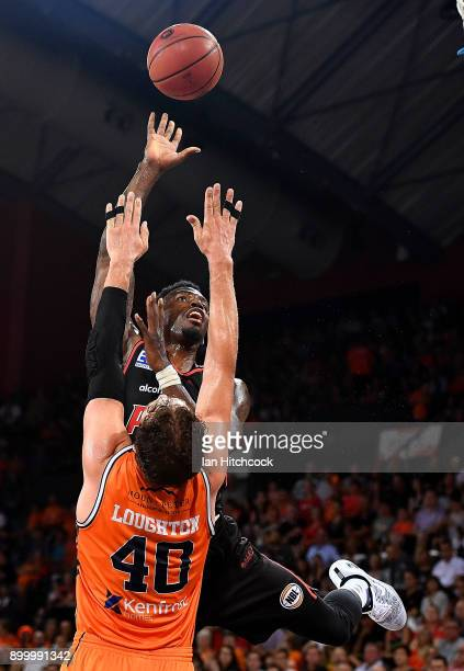 Derek Cooke Jr of the Wildcats takes a jump shot over Alex Loughton of the Taipans during the round 12 NBL match between the Cairns Taipans and the...