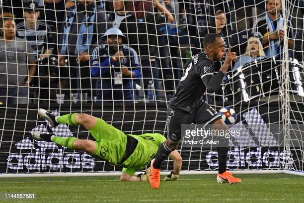 Derek Cornelius of Vancouver Whitecaps FC reacts after scoring the tying goal against Tim Melia of Sporting Kansas City during the second half on May...