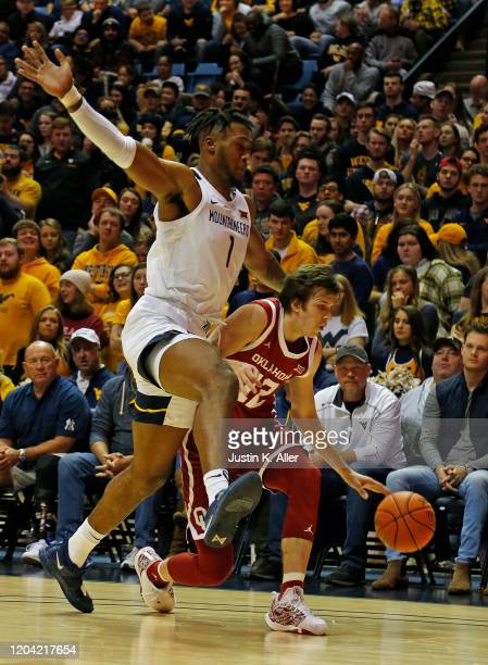Derek Culver of the West Virginia Mountaineers plays defense against Austin Reaves of the Oklahoma Sooners at the WVU Coliseum on February 29 2020 in...