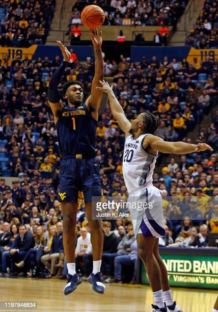 Derek Culver of the West Virginia Mountaineers pulls up for a shot against Xavier Sneed of the Kansas State Wildcats at the WVU Coliseum on February...