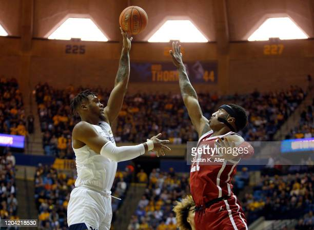 Derek Culver of the West Virginia Mountaineers pulls up for a shot against Kristian Doolittle of the Oklahoma Sooners at the WVU Coliseum on February...