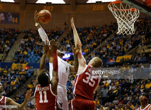 Derek Culver of the West Virginia Mountaineers pulls up for a shot against Brady Manek of the Oklahoma Sooners at the WVU Coliseum on February 29...