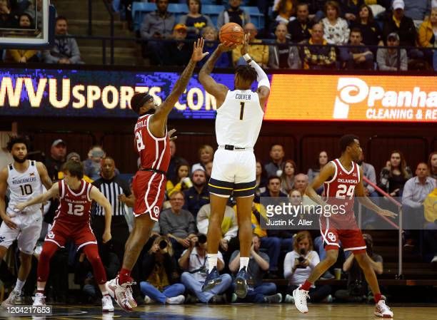 Derek Culver of the West Virginia Mountaineers pulls up for a three against the Oklahoma Sooners at the WVU Coliseum on February 29 2020 in...