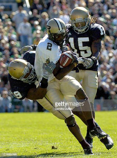 Derek Curry brings down Purdue's Ray Williams after a pass reception in the first quarter of Purdue's 41-16 win over Notre Dame in Notre Dame...