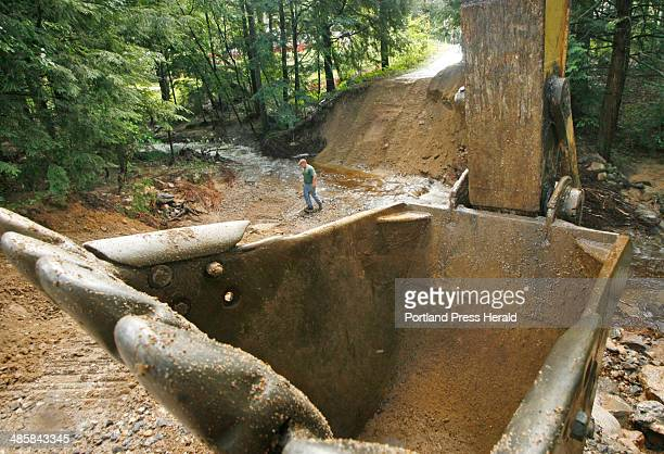 Heavy rain washed out culverts and a couple sections of road at the intersection of Comanche Lane and Kennebec Drive in West Lebanon Friday Aug 8...