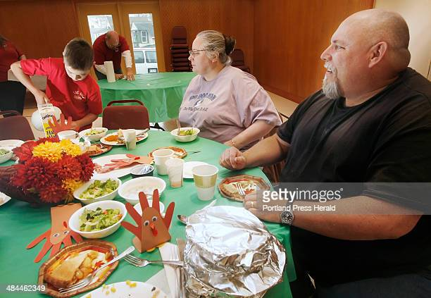 Joshua Samuelson of Gorham makes a cup of coffee for Sheila Martin Thursday November 22 while she has Thanksgiving dinner with Terry DuDevior right...