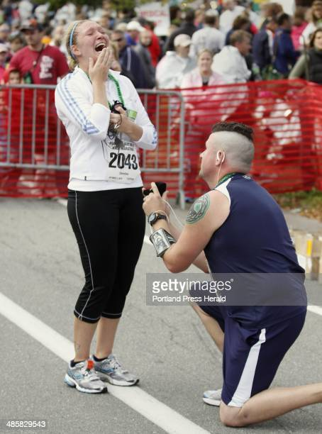 Sean McCarthy of Grafton MA makes a marriage proposal to Christina Baker also of Grafton MA after they finished the half marathon run at the 2010...