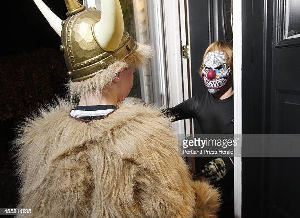 Zachary Strzegowski hands some candy to a trickortreating Viking at his house in Scarborough