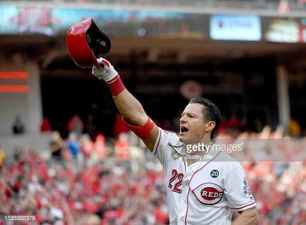Derek Dietrich of the Cincinnati Reds celebrates after hitting a three run home run during the seventh inning of the game against the Pittsburgh...