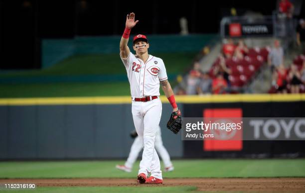 Derek Dietrich of the Cincinnati Reds celebrates after the final out of the 11-6 win against the Pittsburgh Pirates at Great American Ball Park on...