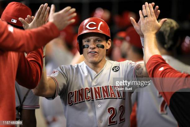 Derek Dietrich of the Cincinnati Reds celebrates with teammates after scoring a run in the third inning against the Milwaukee Brewers at Miller Park...