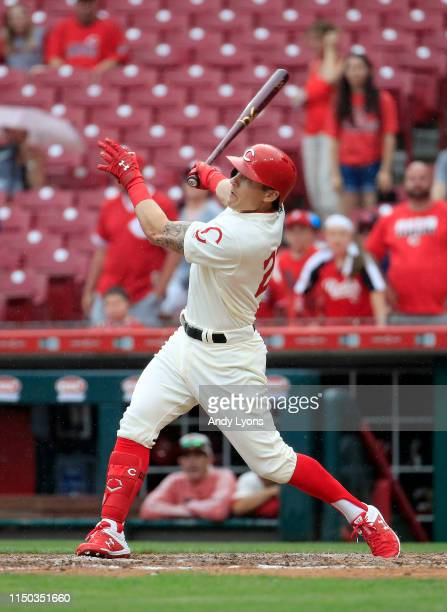 Derek Dietrich of the Cincinnati Reds hits a home run in the 9th inning against the Los Angeles Dodgers at Great American Ball Park on May 19 2019 in...