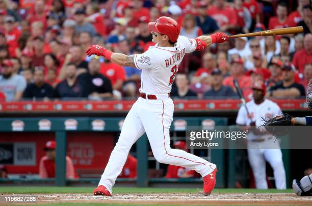 Derek Dietrich of the Cincinnati Reds hits a home run in the first inning against the Houston Astros at Great American Ball Park on June 18 2019 in...
