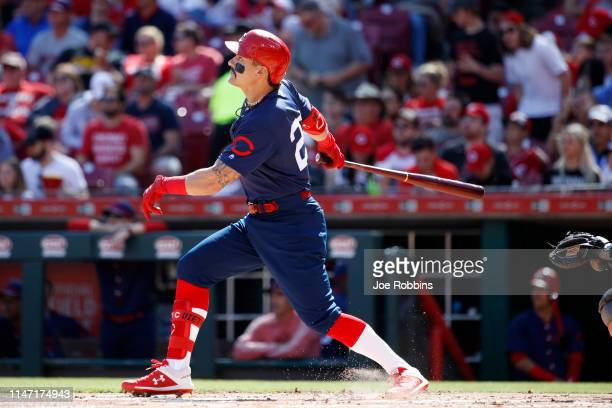 Derek Dietrich of the Cincinnati Reds hits a solo home run, the team's third straight, in the first inning against the San Francisco Giants at Great...