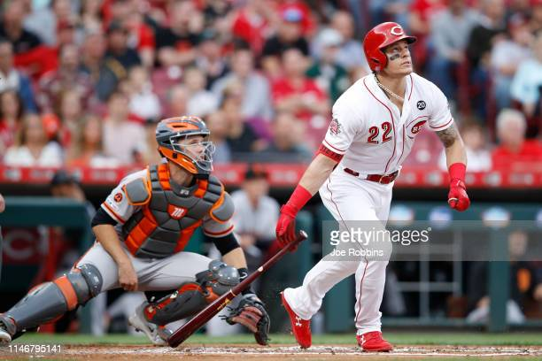 Derek Dietrich of the Cincinnati Reds hits a three-run home run in the first inning against the San Francisco Giants at Great American Ball Park on...