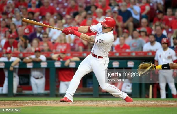 Derek Dietrich of the Cincinnati Reds hits a two run home run in the 7th inning against the Pittsburgh Pirates at Great American Ball Park on May 28...