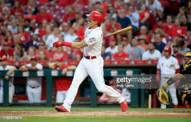 Derek Dietrich of the Cincinnati Reds hits a two run home run in the 7th inning against the Pittsburgh Pirates at Great American Ball Park on May 28,...
