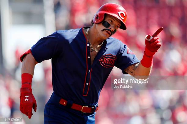 Derek Dietrich of the Cincinnati Reds reacts after hitting a solo home run the team's third straight in the first inning against the San Francisco...