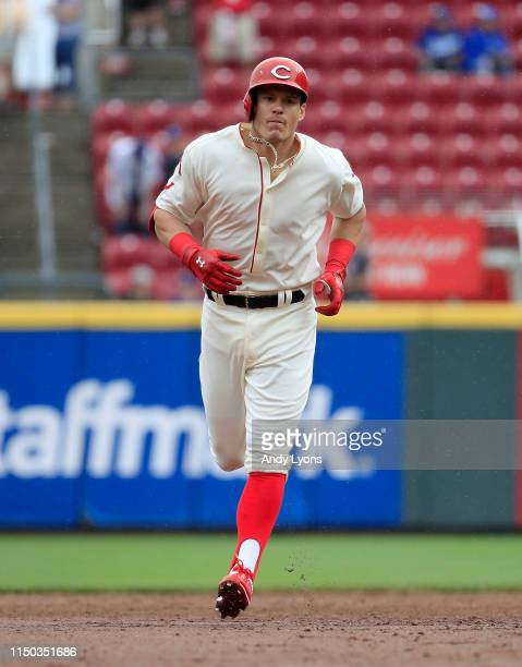 Derek Dietrich of the Cincinnati Reds runs the bases after hitting a home run in the 9th inning against the Los Angeles Dodgers at Great American...