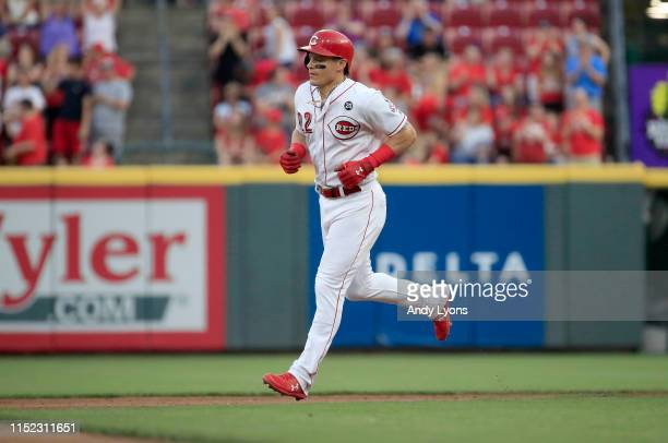 Derek Dietrich of the Cincinnati Reds runs the bases after hitting a two run home run in the 7th inning against the Pittsburgh Pirates at Great...