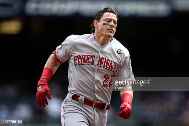 Derek Dietrich of the Cincinnati Reds runs to third base in the first inning against the Milwaukee Brewers at Miller Park on June 22 2019 in...