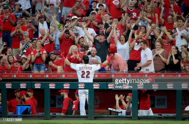 Derek Dietrich of the Cincinnati Reds takes a curtain call after hitting a two run home run in the 7th inning against the Pittsburgh Pirates at Great...