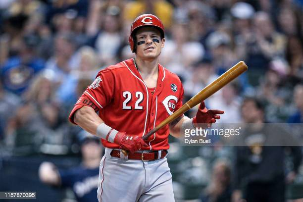 Derek Dietrich of the Cincinnati Reds walks back to the dugout after striking out in the first inning against the Milwaukee Brewers at Miller Park on...