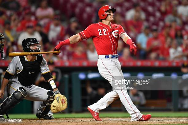 Derek Dietrich of the Cincinnati Reds watches his home run in the seventh inning against the Pittsburgh Pirates at Great American Ball Park on May 27...