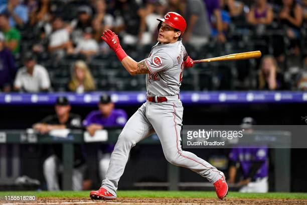 Derek Dietrich of the Cincinnati Reds watches the flight of a sixth inning three-run homerun against the Colorado Rockies at Coors Field on July 13,...
