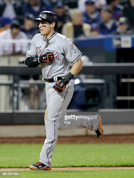 Derek Dietrich of the Miami Marlins celebrates his two run home run in the eighth inning against the New York Mets at Citi Field on May 22, 2018 in...