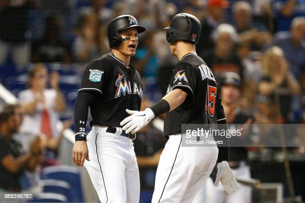 Derek Dietrich of the Miami Marlins celebrates with Brian Anderson after he hit a two-run home run in the sixth inning against the New York Mets at...