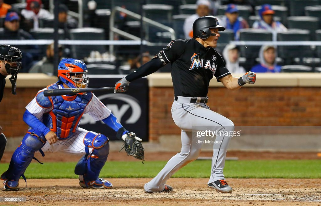 Derek Dietrich #32 of the Miami Marlins follows through on a fifth inning run scoring base hit against the New York Mets at Citi Field on April 7, 2017 in the Flushing neighborhood of the Queens borough of New York City.