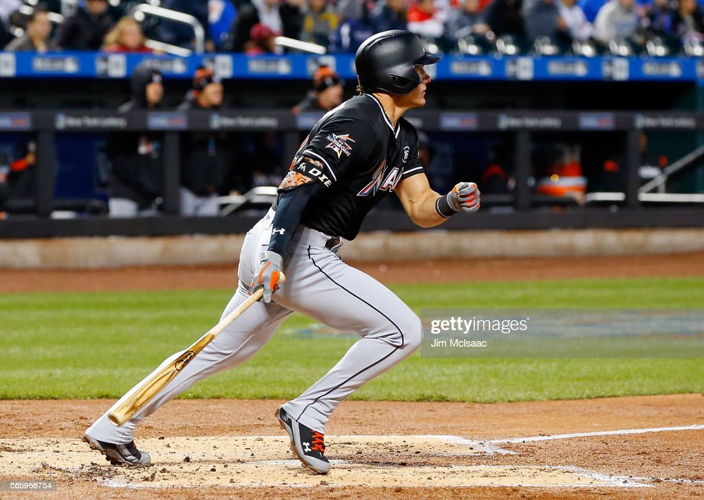 Derek Dietrich #32 of the Miami Marlins follows through on a second inning two run triple against the New York Mets at Citi Field on April 7, 2017 in the Flushing neighborhood of the Queens borough of New York City.