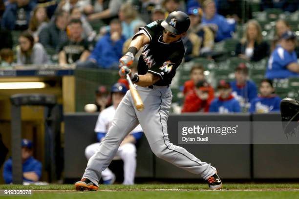 Derek Dietrich of the Miami Marlins hits a single in the first inning against the Milwaukee Brewers at Miller Park on April 20 2018 in Milwaukee...