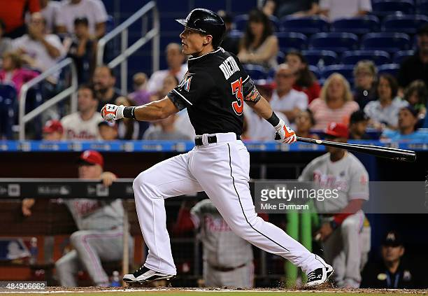 Derek Dietrich of the Miami Marlins hits a two run doubles during a game against the Philadelphia Phillies at Marlins Park on August 22 2015 in Miami...