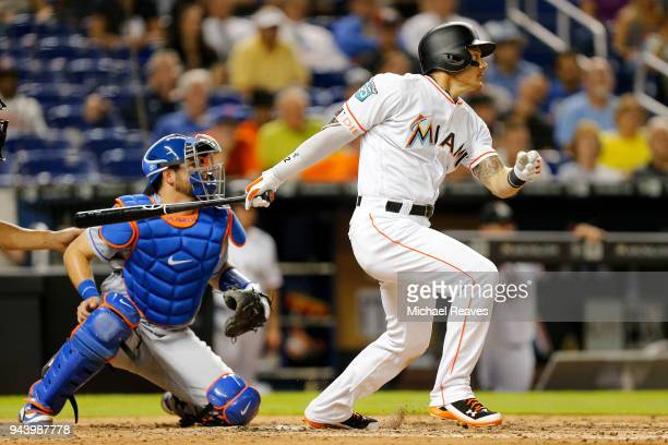 Derek Dietrich of the Miami Marlins hits an RBI single in the sixth inning against the New York Mets at Marlins Park on April 9 2018 in Miami Florida