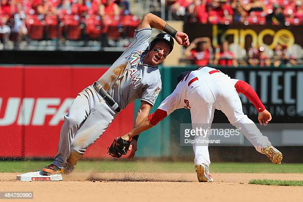 Derek Dietrich of the Miami Marlins is caught stealing second base in the seventh inning at Busch Stadium on August 16, 2015 in St. Louis, Missouri.